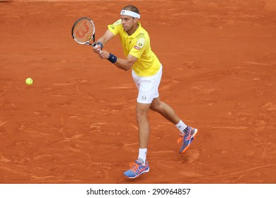 PARIS, FRANCE- MAY 28, 2015 :Professional tennis player Gilles Muller of Luxembourg in action during his second round match at Roland Garros 2015 in Paris, France