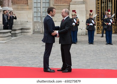 PARIS, FRANCE - MAY 29, 2017 : President of France Emmanuel Macron welcoming Vladimir Putin, the President of Russian Federation at the Palace of Versailles for a working visit.
