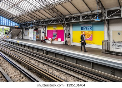 PARIS, FRANCE - MAY 29, 2018: Interior of Bir-Hakeim station of the Paris Metro. The track and station form an elevated viaduct in the centre above the Boulevard de Grenelle.
