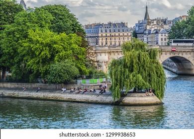 """PARIS, FRANCE - MAY 29, 2018: Paris Pont Neuf (""""New Bridge"""") and Ile de la Cite (Cite Island). Paris Pont Neuf is the oldest (1607) standing bridge across the river Seine in Paris."""