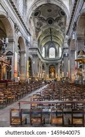 PARIS, FRANCE - MAY 29, 2019: Interior of Paris Saint-Sulpice church (Eglise Saint-Sulpice, 1754). Saint-Sulpice church is one of the biggest churches in Paris. Place Saint-Sulpice, Paris, France.