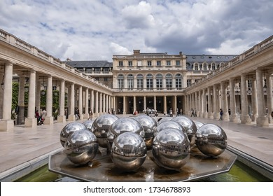 Paris, France - May 29, 2019: Fountain in the Orleans Gallery (Galerie d'Orleans) in the Palais Royal (Royal Palace). Palais Royal built in 1629 by Cardinal Richelieu.