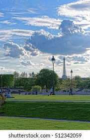 Paris, France - May 3, 2012: People in the park with a view on Eiffel Tower in Paris, France. This is a cultural icon.