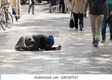 PARIS, FRANCE - MAY 3: Gypsy Beggars begging for money on Avenue des Champs-Elysees in Paris France on May 3.2018
