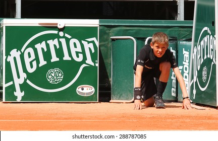 PARIS, FRANCE- MAY 30, 2015: Ball boy during match at Roland Garros 2015 in Paris, France