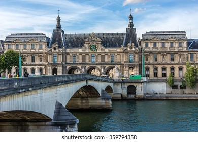PARIS, FRANCE - MAY 30, 2015: View of famous Louvre Museum from the Seine River. Louvre Museum is one of the largest and most visited museums worldwide.