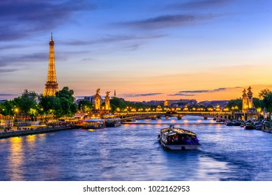 Paris, France - May 30, 2017: Sunset view of Eiffel tower, Pont Alexandre III and Seine river in Paris, France. Architecture and landmarks of Paris. Postcard of Paris