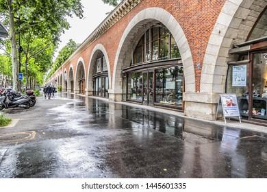 PARIS, FRANCE - MAY 30, 2019: Le Viaduc des Arts on Avenue Daumesnil - former railway line viaduct today housing art galleries, shops, restaurants and Promenade Plantee park on its top. Paris, France.