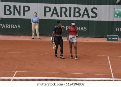 PARIS, FRANCE - MAY 30:  Venus and Serena Williams (USA) compete in round 2 at the The French Open on May 30, 2018 in Paris, France.