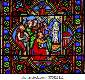 PARIS, FRANCE -  MAY 31, 2015 Worshiping Virgin Mary Jesus Christ Stained Glass Notre Dame Cathedral Paris France.  Notre Dame was built between 1163 and 1250 AD.