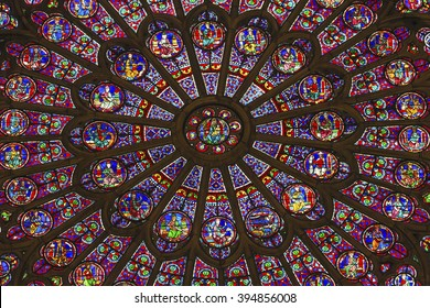 PARIS, FRANCE - MAY 31, 2015 North Rose Window Virgin Mary Jesus Disciples Stained Glass Notre Dame Cathedral  Paris France.  Notre Dame built between 1163 and 1250 AD, window oldest from 1250.