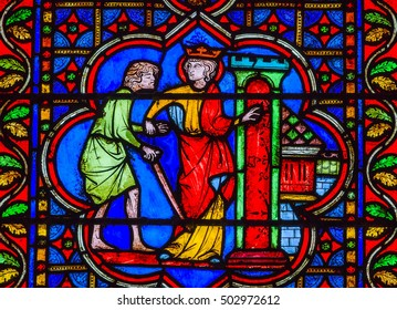 PARIS, FRANCE - MAY 31, 2015 King Sword Castle Medieval Stories Stained Glass Notre Dame Cathedral Paris France.  Notre Dame was built between 1163 and 1250 AD.