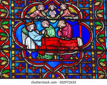 PARIS, FRANCE - MAY 31, 2015 King Death Bed Angels Medieval Stories Stained Glass Notre Dame Cathedral Paris France.  Notre Dame was built between 1163 and 1250 AD.