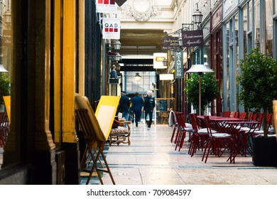 PARIS, FRANCE - MAY 31, 2016:The passage Jouffroy (architects Francois Destailleur and Romain de Bourges, 1846) - shopping area with art gallery, stores, book stores,coffee shop, confectionery.