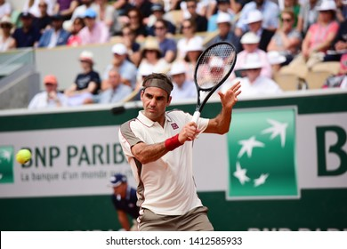 Paris, France - May 31 2019: Norway's Casper Ruud playing Switzerland's Roger Federer in 3rd round match at Roland Garros on court Suzanne Lenglen