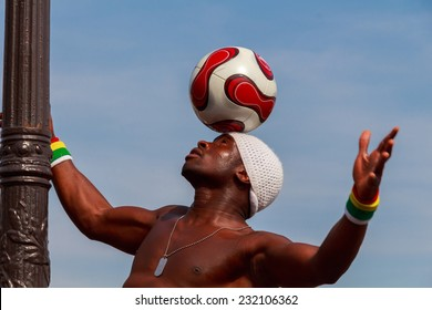 Paris, France - May 4, 2014: Freestyle with the ball. Iya Traore juggling a soccer ball in front of Sacre Coeur.