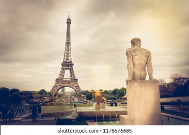 Paris, France - May 5, 2017: Statue of the Man, sculptor Pierre Traverse (1892-1979) located in the garden of Trocadero and looking at the Eiffel Tower on a spring day.
