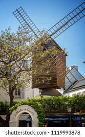 PARIS, FRANCE - MAY 5: Moulin de la Galette, famous restaurant and old wooden windmill, on May 5, 2018 in Montmartre, Paris France