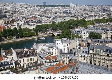 Paris, France - May 6, 2018: View of Paris skyline, Seine river and bridges seen from the top of Notre Dame cathedral