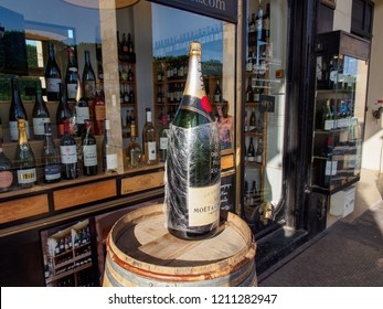 PARIS, FRANCE - MAY 6, 2018: Storefront of fine wine retailer with a large, Nebuchadnezzar-sized bottle of Moet & Chandon Brut Champagne. Travel and cuisine.
