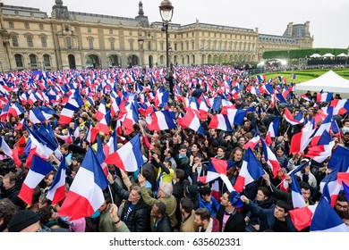 PARIS, FRANCE - MAY 7, 2017 : People at the Carousel du Louvre are gathered to celebrate the election of the new President of France Emmanuel Macron.