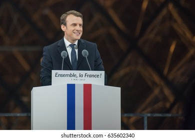 PARIS, FRANCE - MAY 7, 2017 : Emmanuel Macron has just been elected as President of France speaking at the Carousel du Louvre for his first speech in front of tens of thousands people.