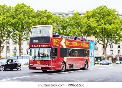 PARIS, FRANCE - MAY 7, 2017: Two-storeyed tourist bus in the street of Paris