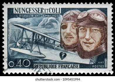 Paris, France - May 8, 1967: 40th anniversaries of the attempted transatlantic flight of Charles Nungesser and Francois Coil, French aviators. Stamp issued by French Post in 1967.