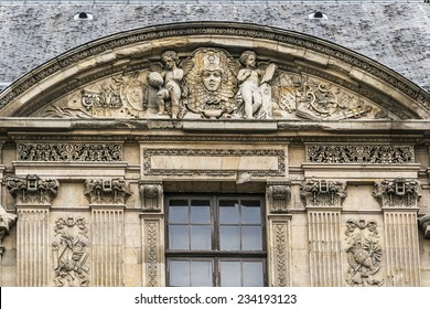 PARIS, FRANCE - MAY 8, 2014: Architectural fragments of Louvre building. Louvre Museum is one of the largest and most visited museums worldwide.