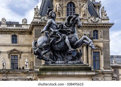 PARIS, FRANCE - MAY 8, 2014: View of Louvre Museum courtyard. Louvre Museum is one of the largest and most visited museums worldwide.