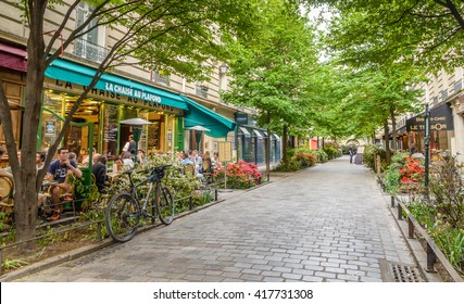 Paris, France - May 8, 2016. A quiet street with restaurants in the bohemian Marais district of Paris