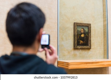 "PARIS, FRANCE - MAY 8, 2017: Visitors take photo of Leonardo DaVinci's ""Mona Lisa"" at the Louvre Museum."