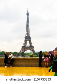 PARIS, FRANCE - MAY 8, 2017: Peoples with Eiffel Tower at Paris. The Eiffel Tower is the most visited monument of France.