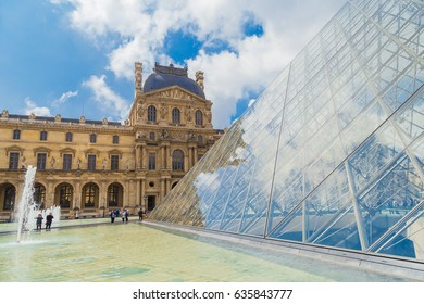 PARIS, FRANCE - MAY 8, 2017: Cityscape Paris Louvre museum . View fragments of Louvre buildings. Louvre Museum is one of the largest and most visited museums worldwide.