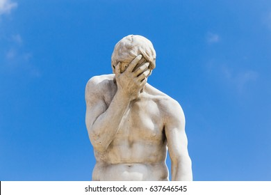 PARIS, FRANCE - MAY 8, 2017: A facepalm statue. In The Garden Of Tuileries, near Louvre.