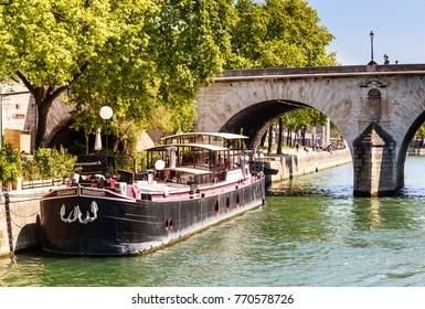 PARIS, FRANCE - MAY 9, 2017: Houseboat  near Pont Marie, Ile Saint-Louis, Paris, France.