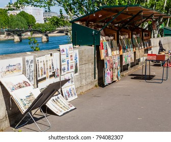 PARIS, FRANCE - MAY 9, 2017: Sale of pictures on the embankment of the river Seine. Paris, France