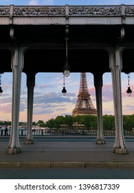Paris, France - May 9, 2019: View to the Eiffel tower from Bir Hakeim bridge at the dusk light