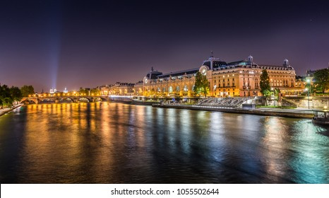 Paris, France. Night view of the dOrsay Museum and the Seine river