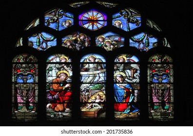 PARIS, FRANCE - NOV 05, 2012: Nativity Scene stained glass in Church of St Eustace, built in 1532-1632 and considered a masterpiece of late Gothic architecture, in Paris on Nov 05, 2012.