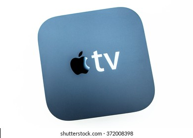 PARIS, FRANCE - NOV 10, 2015: New Apple TV media streaming  player microconsole by Apple Computers - isolated on white. It has new touch remote swipe-to-select with integrated Siri and motion sensor