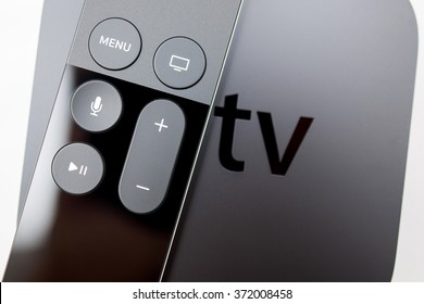 PARIS, FRANCE - NOV 10, 2015: New Apple TV media streaming  player microconsole by Apple Computers -  .  It has new touch remote swipe-to-select with integrated Siri and motion sensor