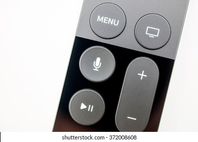PARIS, FRANCE - NOV 10, 2015: Extreme colseup of the New Apple TV media streaming  player microconsole by Apple Computers futuristic touch remote swipe-to-select with integrated Siri  remote