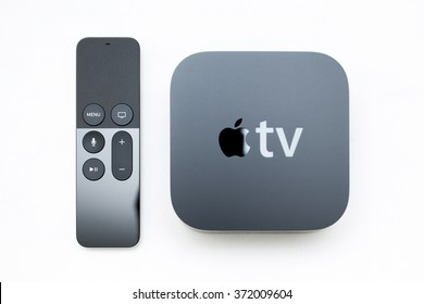PARIS, FRANCE - NOV 10, 2015: Focus on the remote control of the New Apple TV media streaming   by Apple Computers next to the new touch remote with integrated Siri and motion sensor on white