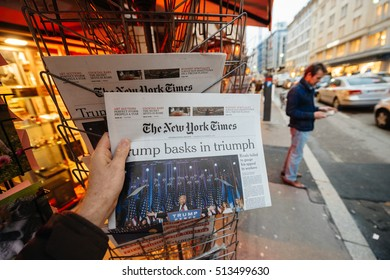 PARIS, FRANCE - NOV 10, 2016: Man buying The New York Times newspaper with  headline  at press kiosk about the US President Elections - Donald Trump is the 45th President of United States of America