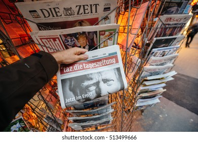 PARIS, FRANCE - NOV 10, 2016: Man buying German newspaper Tag Die Tageszeitung with title press kiosk about the US President Elections - Donald Trump is the 45th President of United States of America