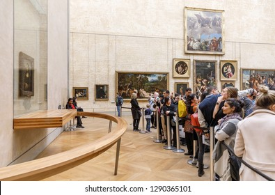 PARIS, FRANCE - Nov 10, 2017: Visitors do selfie and take photo of Leonardo Da Vinci's Mona Lisa at the Louvre Museumn. Mona Lisa or La Gioconda is one of the most valuable paintings in the world
