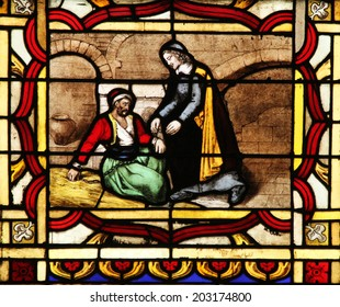 PARIS, FRANCE - NOV 11, 2012: Saint Vincent de Paul helps a prisoner, stained glass from Church of St-Germain-l'Auxerrois founded in the 7th century, was rebuilt many times over several centuries.