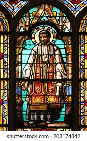 PARIS, FRANCE - NOV 11, 2012: Saint Vincent de Paul, stained glass from Church of St-Germain-l'Auxerrois founded in the 7th century, was rebuilt many times over several centuries.