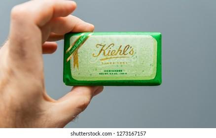 PARIS, FRANCE - NOV 18, 2018: Man POV hand holding Kiehl's Limited Edition soap Banneker coriander scent,